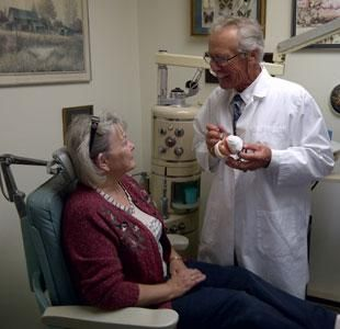 Owen Sound Denture Specialist talking to a patient about denture options